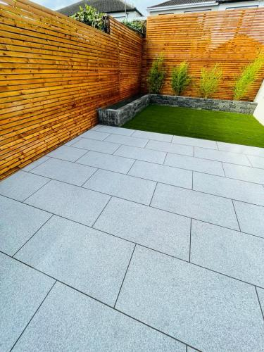 Silver-Granite-Effect-Porcelain-Patio-Installed-By-Agora-Outdoor-Solutions