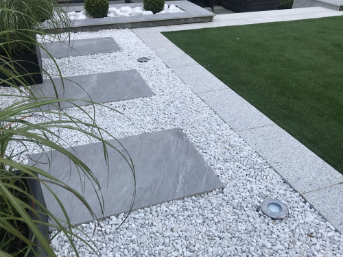 Grigio-Grey-Porcelain--Used-As-Stepping-Stones-Through-White-Marble-Chippings--Edged-with-Silver-Granite-Paving-Slabs