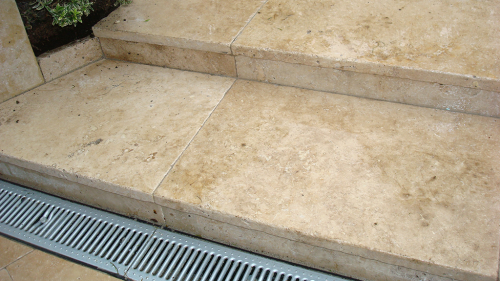 Steps With Tumbled Travertine .
